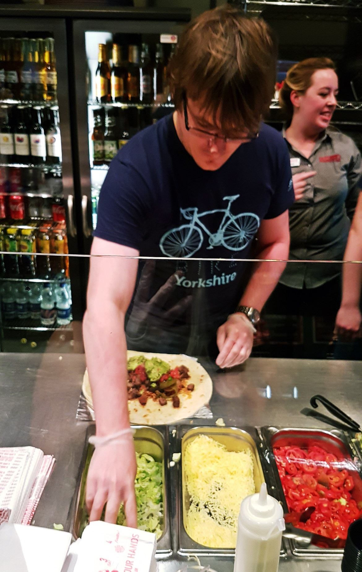 TC grabbing some lettuce - Burrito Masterclass with Barburrito, review by BeckyBecky Blogs