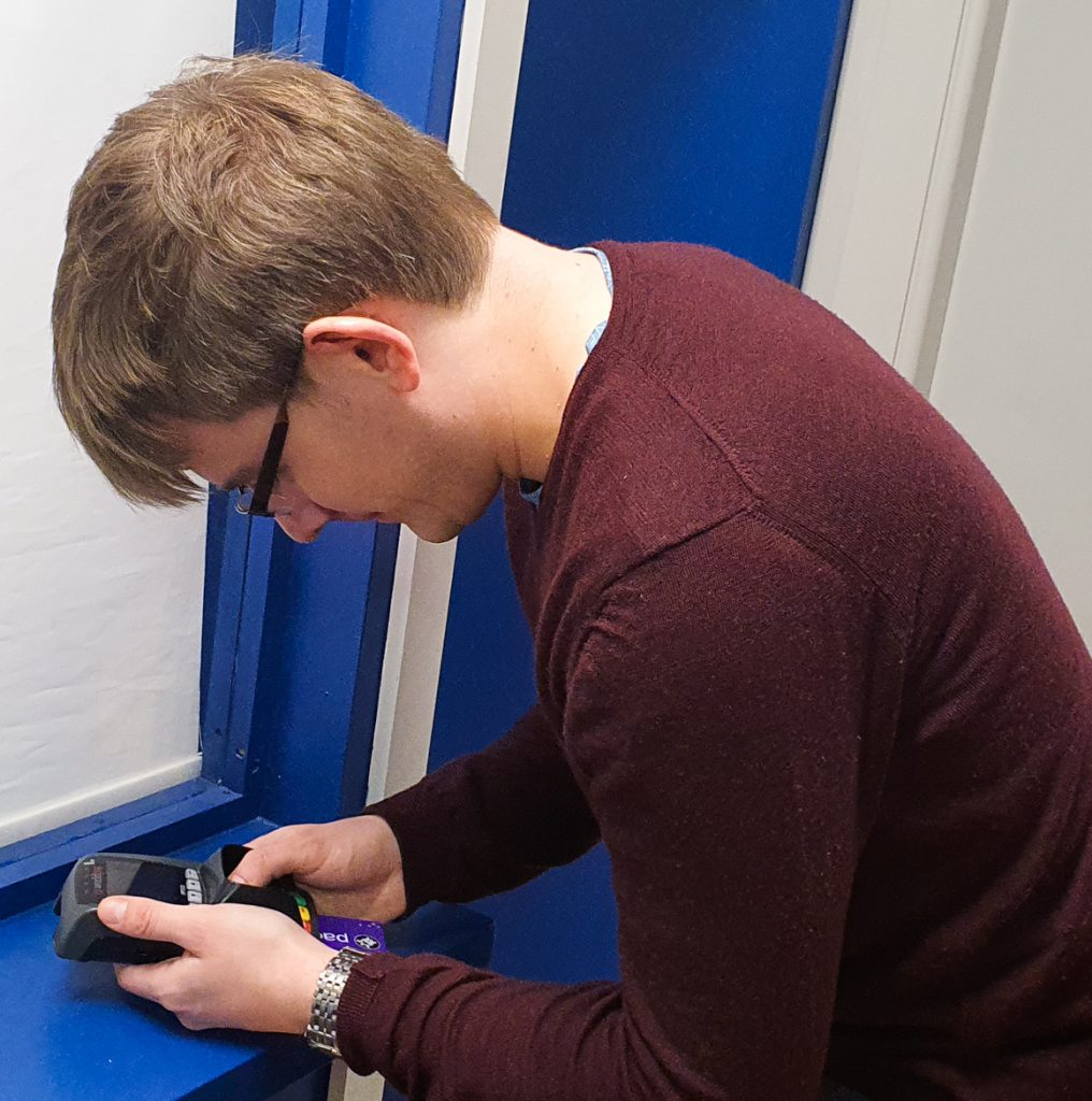 Tim entering a code - Gem Runner escape room by Lucardo Manchester, review by BeckyBecky Blogs