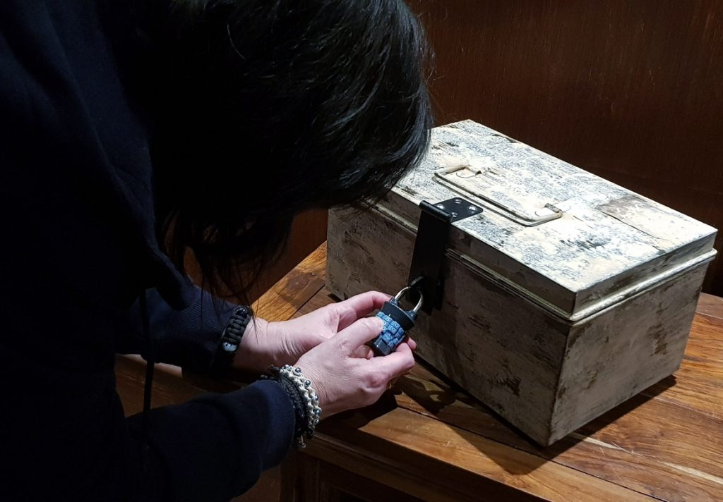 Opening a chest - Follow in my Footsteps by Kanyu Escape, Leeds escape room review by BeckyBecky Blogs