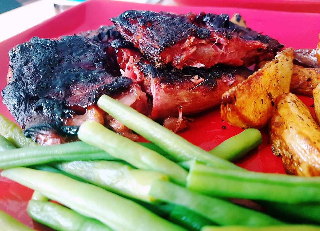 Barbecue ribs served with potato wedges and green beans, made with produce from Kirkgate Market in Leeds