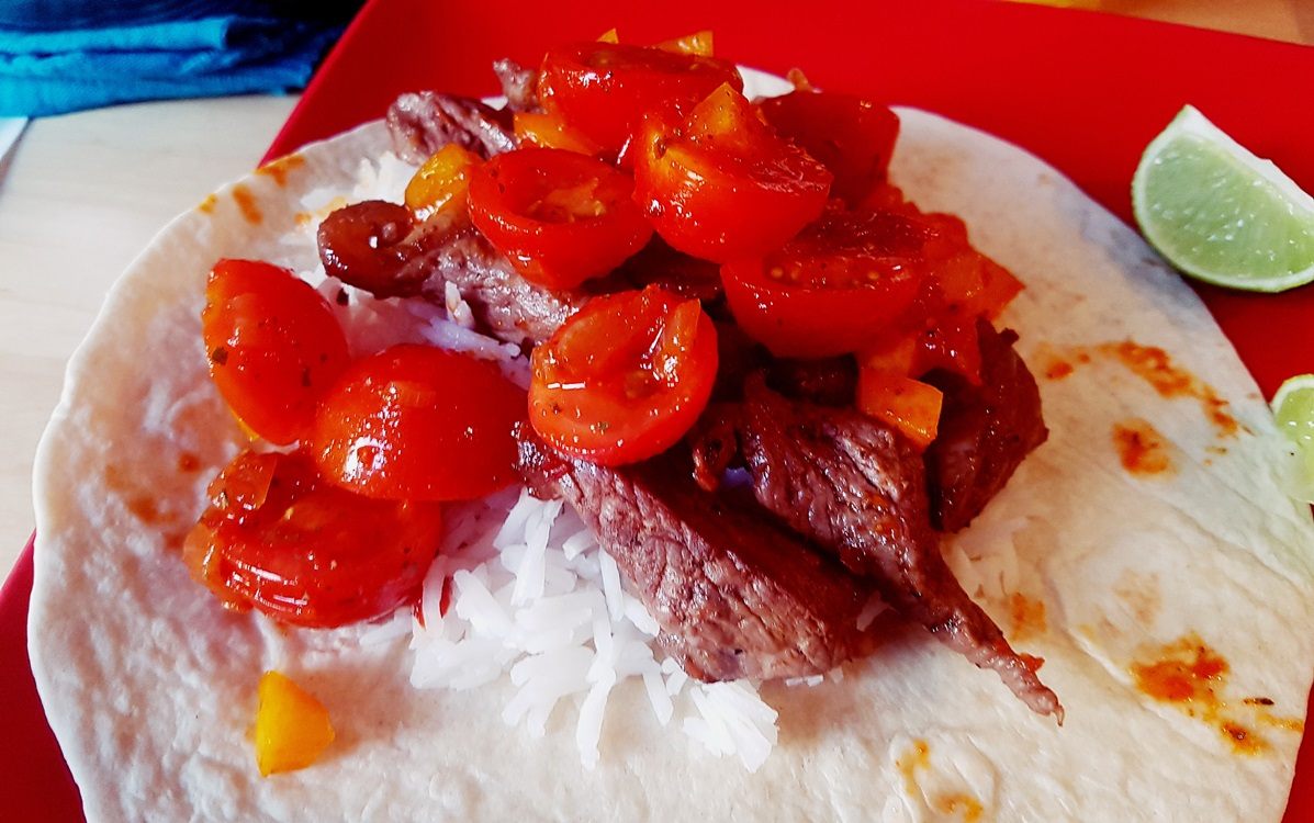 Steak burritos with cherry tomato salsa, warm tortillas and white rice, made with produce from Kirkgate Market in Leeds