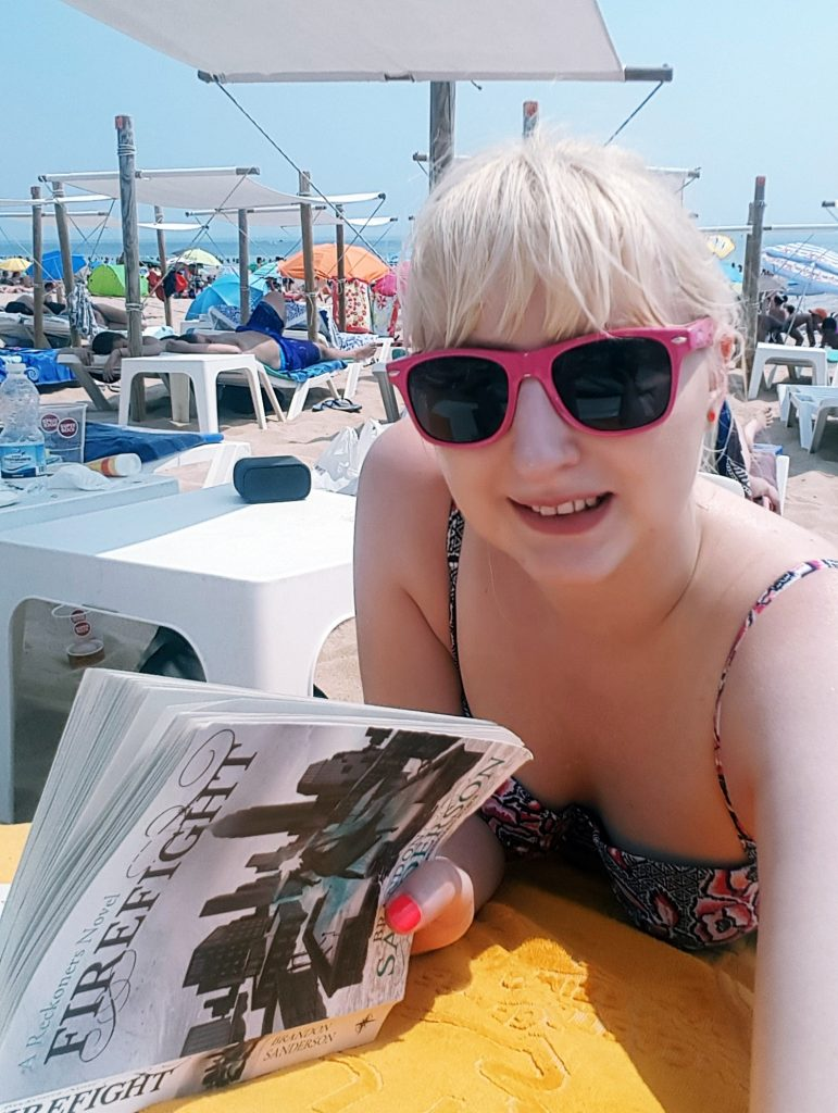 Lounging and reading a book at Carcavelos beach - Things to Do in Lisbon, Portgual, travel blog by BeckyBecky Blogs