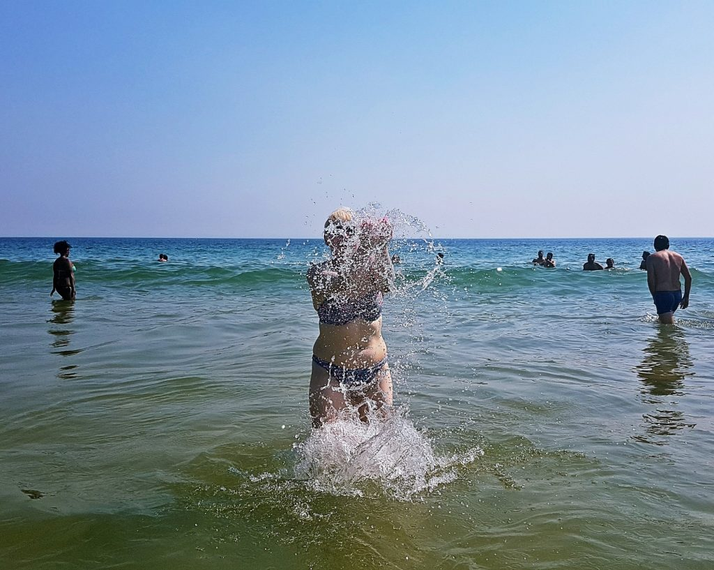 Enjoying the sea at Carcavelos beach - Things to Do in Lisbon, Portgual, travel blog by BeckyBecky Blogs