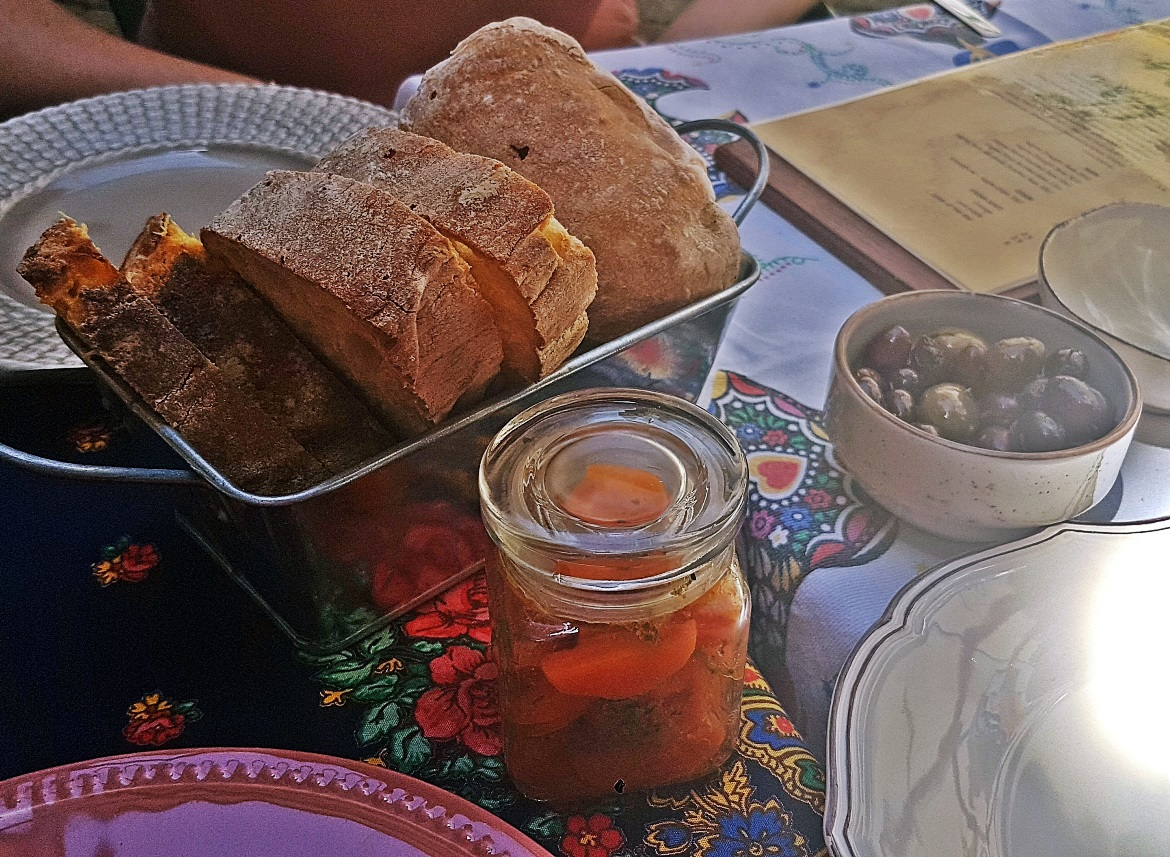 Bread, carrot salad and olives at Restaurante O Conquistador - Tips for visiting Lisbon by BeckyBecky Blogs