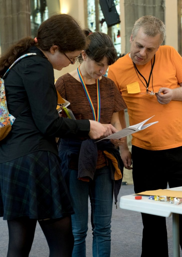 Pouring over a handbook - Trope High Megagame in Photos by BeckyBecky Blogs